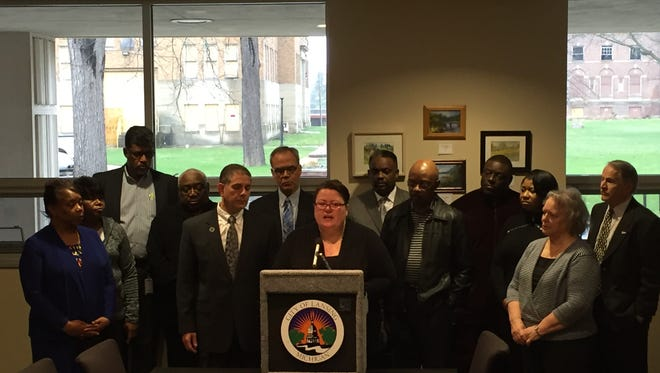 Lansing Mayor Virg Bernero (left) and the Greater Lansing Housing Coalition's Julie Powers (center) were some of the community leaders Thursday who expressed concern about City Council's stance on a low income housing project.
