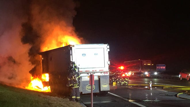 Firefighters extinguish flames that tore through a tractor-trailer on Interstate 87 in Nyack on Oct. 13, 2016.
