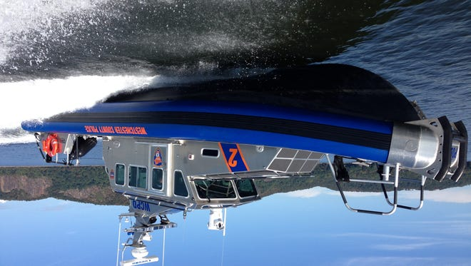 Officers aboard Westchester's Marine 2 patrol boat, which was used to escort a humpback whale out of the Hudson River Friday, spotted a man who jumped from the George Washington Bridge.