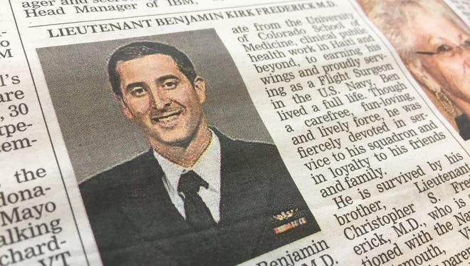 Lt. Benjamin Frederick is seen in this photo with his obituary in the Burlington Free Press. Frederick, 33, who attended Mount Mansfield Union and whose parents live in Underhill, died at the Marine Corps Air Station in Iwakuni, Japan, on Saturday, Dec. 17, 2016.