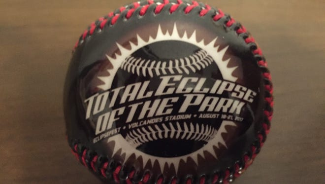 A commemorative Total Eclipse of the Park souvenir baseball is currently available in the Volcanoes Team Store at Volcanoes Stadium.