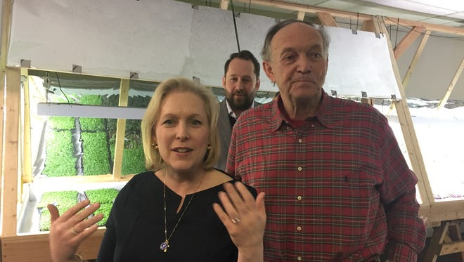 Sen. Kirsten Gillibrand, left, tours Indoor Organic Gardens in the City of Poughkeepsie with owner Brud Hodgkins, right.
