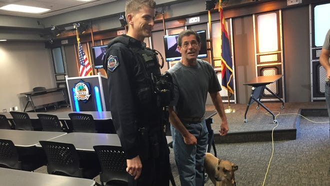 Officer Robert Goodrich, John Tenaglia and Sparky at the Mesa Police Department.