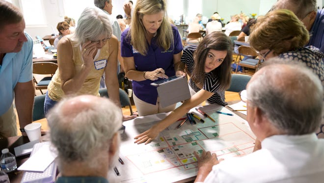 Vero Beach residents and members of the Cultural Arts Village Leadership Team meet in 2015 with a member of the Treasure Coast Regional Planning Council to discuss the Vero Beach Cultural Arts Village Design Charette.