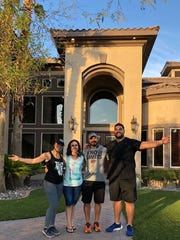 NY Giants rookie offensive lineman Will Hernandez pulled off the surprise of a lifetime when he bought his parents a house. Pictured here (from left to right: sister Kathy, mom Angelica, dad Robert, Will).