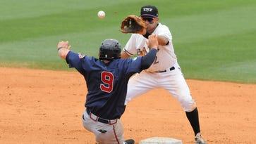 Louisville's Hernan Iribarren alert as he attempts to catch Gwinnett's Sean Kazmar out at second base.