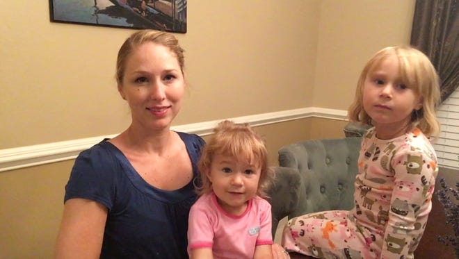 Holly Moore, manager of network engagement at USA TODAY and mom to 2-year-old Penny (center) and 4-year-old Lucy (right), has three excuses why she goes to the gym.