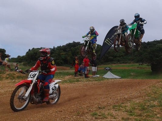 636341294911094815--59-Robert-Terrel-leads-a-high-flying-trio-of-novice-class-riders-Sunday-at-the-eigth-round-of-the-Guam-Monster-Motocross-Championships-1-.jpg