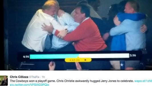 Gov. Chris Christie (right) hugging a group that includes Dallas Cowboys owner Jerry Jones Sunday night.