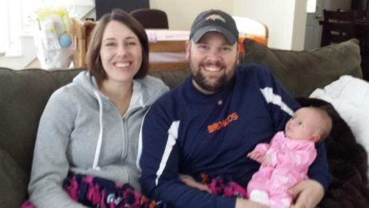 Joshua Quincy Burns and his wife, Brenda Burns, are shown with their daughter, Naomi.