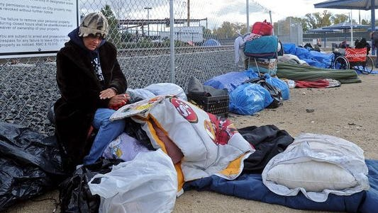 File photo of the now-closed tent city dwellers with their belongings in Reno