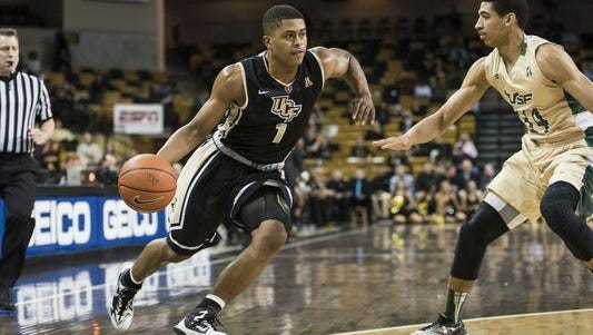 UCF's B.J. Taylor dribbles past a USF defender during a previous rivalry game.