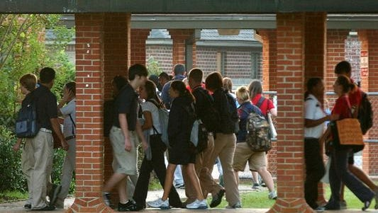 Students move between classes at a Lafayette Parish high school.