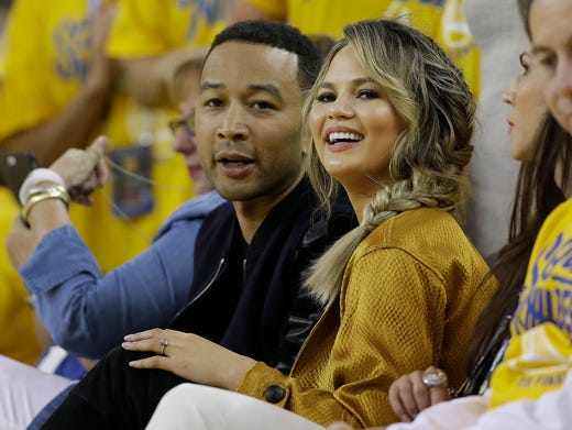 John and Chrissy got sporty at an NBA Finals game between