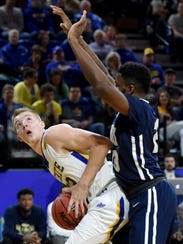 Reed Tellinghuisen makes a move under the basket last year against Oral Roberts