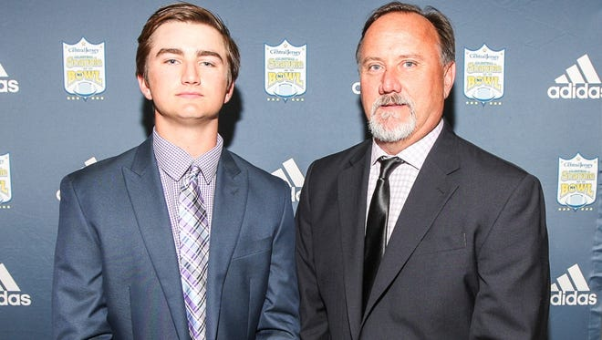 Jack Roarty and his father Tom pose at the Snapple Bowl press conference on May 14.