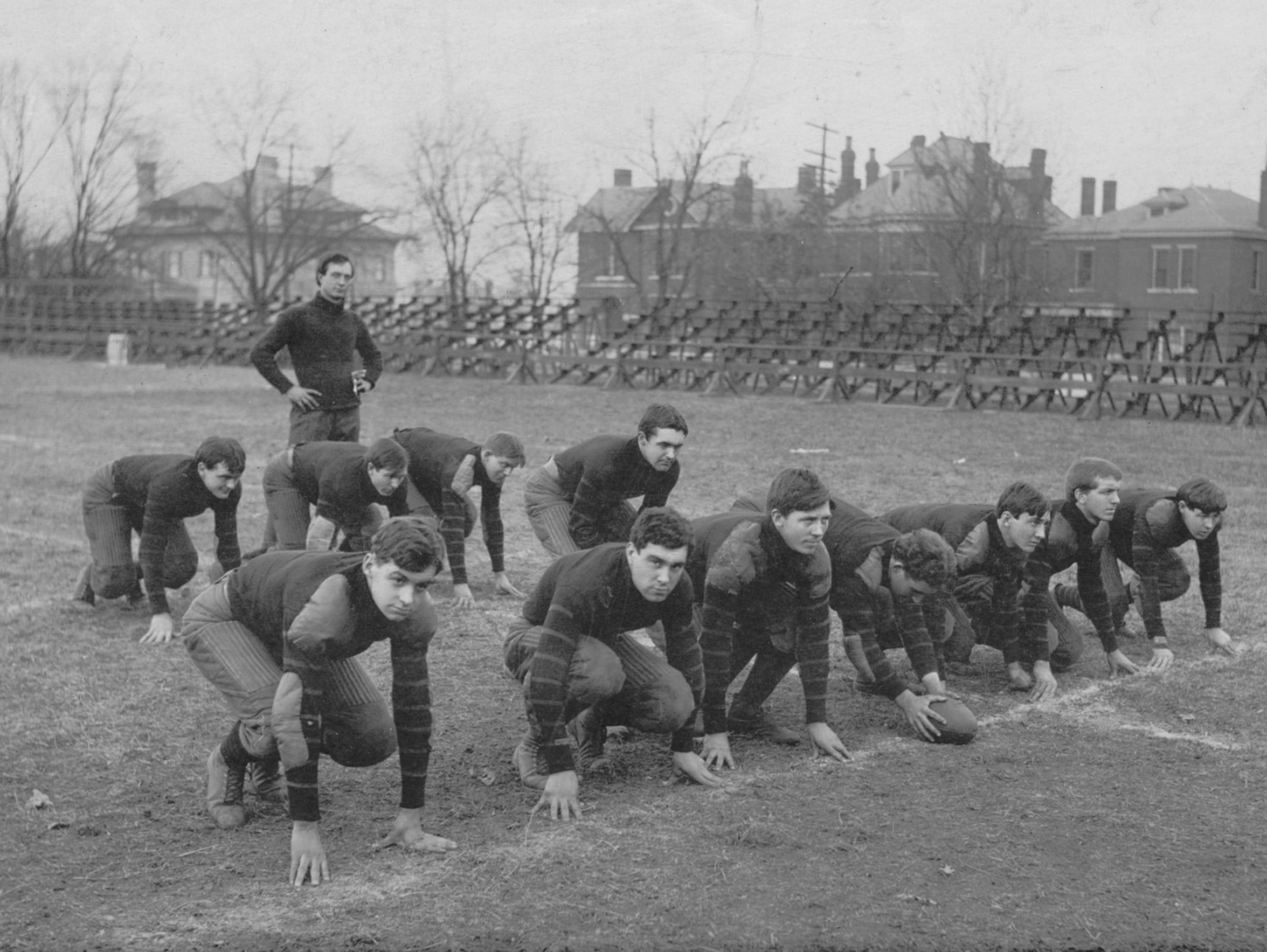 Vanderbilt coach Dan McGugin, standing, was amid his