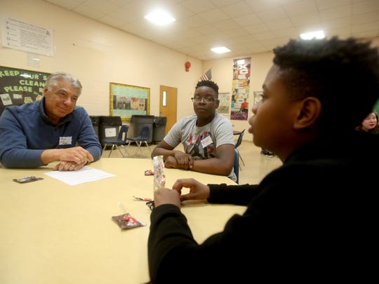 Paul Lagano of Stony Point, a My Brother's Keeper mentor talks with Zion Senat, 14, and Mike Noel, 14, during a My Brother's Keeper mentoring session at Spring Valley High School Dec. 6, 2017.