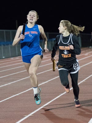 Zane Trace's Hailey Puckett competes in the 4x400-meter relay event Thursday during the RL Davisson Track and Field Invitational at Southeastern High School. Puckett's Pioneers finished second as a team.