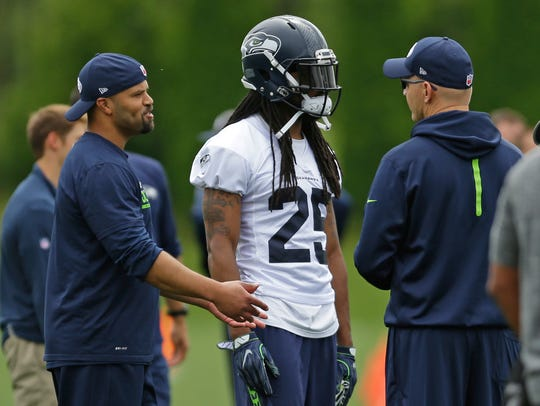 Seahawks cornerback Richard Sherman talks with offensive