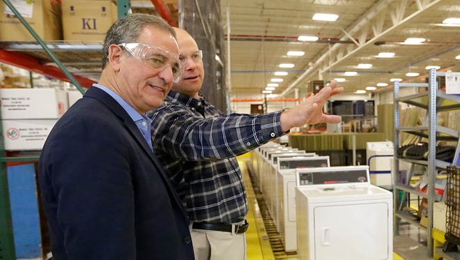 Former Sen. Russ Feingold, left, takes a tour of Alliance Laundry Systems in Ripon with plant manager Todd Kaull Wednesday.