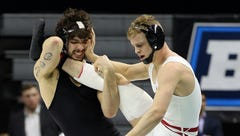Wisconsin Badgers wrestler Eli Stickley, right, has