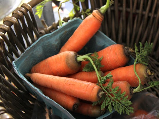 Farmers Market of the Ozarks will be open for a special Christmas Market 3 to 7 p.m. Tuesday so you  can pick up items like these carrots from Millsap Farms.