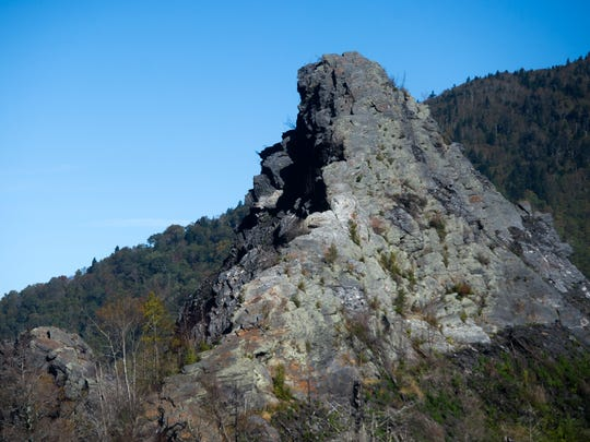 Severe burn damage is visible on a rock face at the summit of Chimney Tops trail in Great Smoky Mountains National Park on Oct. 4. The trail, which has been closed since last year's wildfires, reopened to the public in October; however there is no longer access to the rock face summit or the quarter-mile of trail leading up to it. The trail now includes a new observation point for hikers.