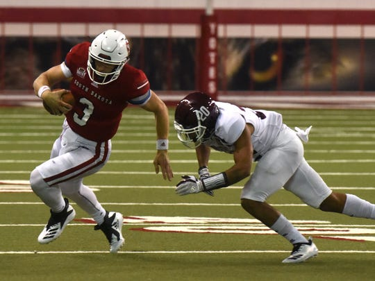 University of South Dakota's Austin Simmons (3) runs