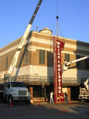 The Weiss & Goldring sign was moved from the store's former location on the corner of Third and DeSoto streets to its location at the Alexandria Mall in 2007. The building's art deco balcony, which was late removed, is visible.