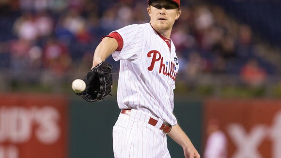 Phillies relief pitcher Jake Diekman (63) receives the ball to pitch during the seventh inning Thursday against the Cincinnati Reds at Citizens Bank Park. Credit: Bill Streicher-USA TODAY Sports