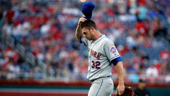 New York Mets starting pitcher Steven Matz scratches his head as he walks to the dugout after being relieved during the first inning of the team's baseball game against the Washington Nationals at Nationals Park, Tuesday, July 31, 2018, in Washington.