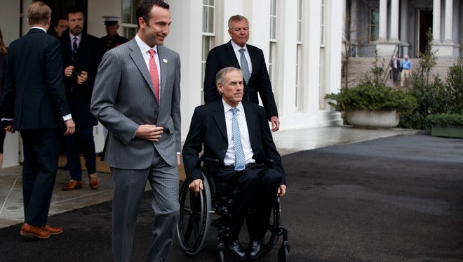 From left, Charter Communications CEO Thomas Rutledge, Texas Gov. Greg Abbott and Reed Cordish, Assistant to the President for Intragovernmental and Technology Initiatives, leave the White House in Washington, Friday, March 24, 2017, to talk to reporters following their meeting with President Donald Trump.