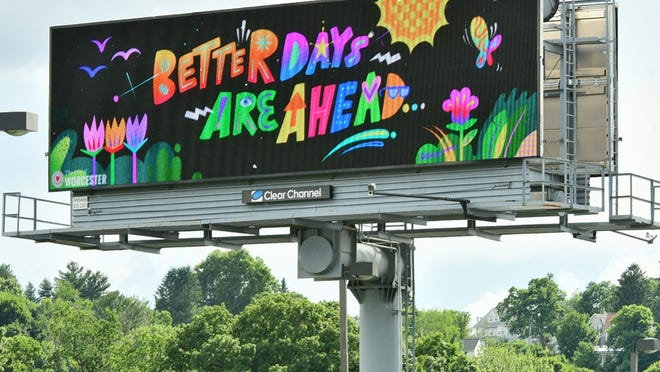 A billboard with a positive message is seen along I-290 Wednesday.
