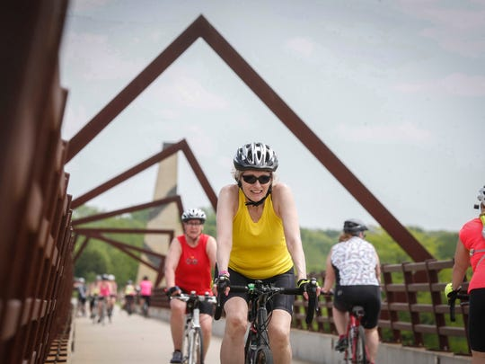 Riders make their way along the High Trestle Trail Bridge west of Madrid during the Pigtails Ride on Saturday, May 19, 2018. The High Trestle Trail is part of the nationwide Rails to Trails project for a coast-to-coast trail.