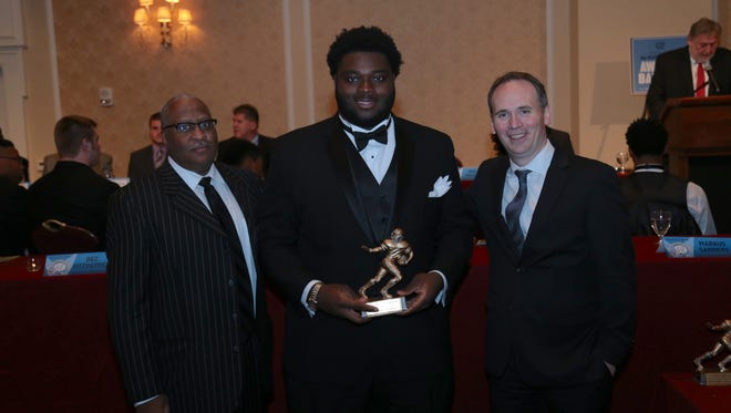 Detroit Free Press sports writer Perry A. Farrell, left, and Detroit Free Press executive editor Robert Huschka photographed with Dream Team award winner Michael Onwenu from Detroit Cass Tech during the 2015 Detroit Free Press Football Awards Banquet on Sunday in Dearborn.