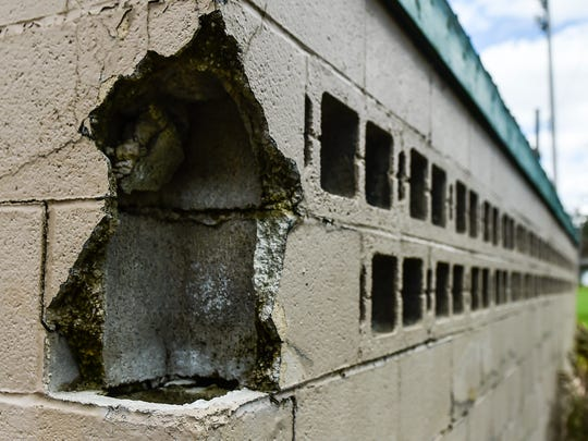 A gaping hole in the away dugout at the Lincoln Park stadium.