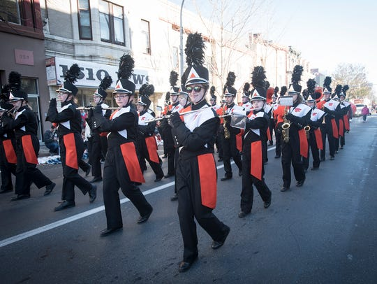 The Palmyra High School Marching Band performs for parade goers in Lebanon Saturday morning.