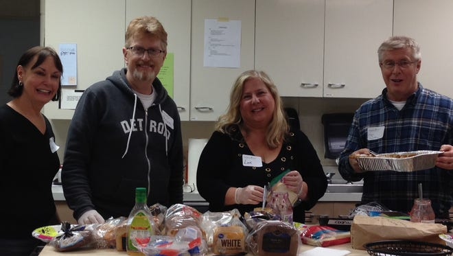 Each SOS guest chose sandwich ingredients. Martha Blenman (from left), Brian Spillane, Lori Mizzi-Spillane, and Jim Blenman make over 50 sandwiches for carry out lunches. They carefully label the bags and guests may add veggies and cookies.