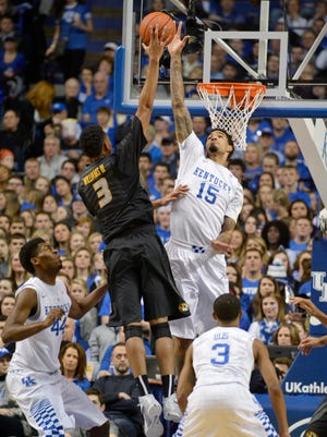 Kentucky's Willie Cauley-Stein defends a shot by Missouri's Johnathan Williams III at Rupp Arena Tuesday Night in Lexington. Kentucky won 86-37.(January 13, 2015)