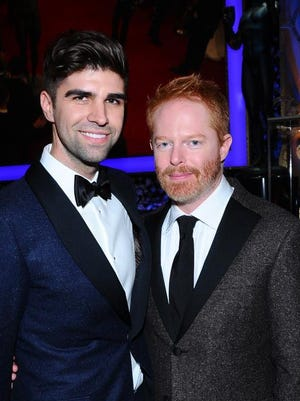 Justin Mikita, left, and Jesse Tyler Ferguson arrive wearing Hickey Feeeman tuxedos for the annual Screen Actors Guild Awards.