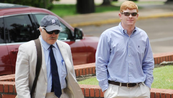 Former University of Mississippi student Graeme Phillip Harris, right, with his attorney David Hill, enter federal court, where Harris pleaded guilty to a charge of using a threat of force to intimidate African-American students and employees at the university, in Oxford, Miss. on Thursday, June 18, 2015. Harris, of Alpharetta, Ga., pleaded guilty Thursday to a misdemeanor charge arising from a noose placed on a statue of civil rights activist James Meredith. (AP Photo/Oxford Eagle, Bruce Newman)
