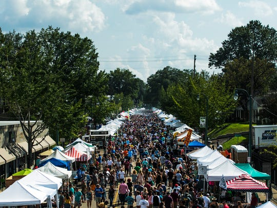 September 16, 2017 - People walk along S. Cooper St. during the 30th annual Cooper-Young Festival on Saturday. The event was expected to draw an attendance of around 130,000 people.