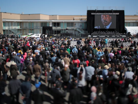 Crowds gather outside the Lorraine Motel and National