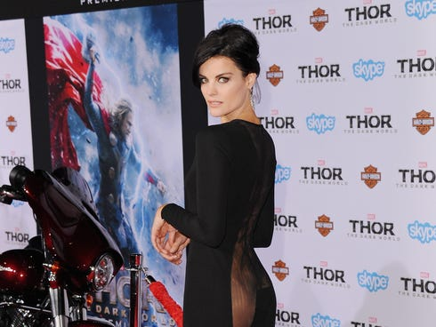 Jaimie Alexander shows the backside of her dress at the 'Thor: The ...