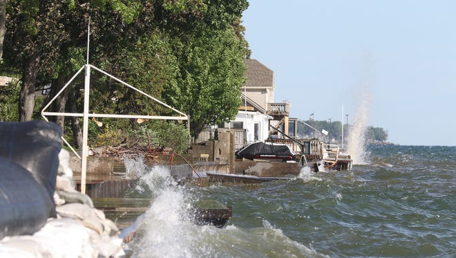 Winds from the northeast whip up the waves on Lake Ontario.  Homes along Edgemere Drive are dealing with water on their property again. (June 14, 2017)