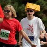 Wearing a cheesehead, #3132 ROSS BENDER approaches the finish line while competing in the Men's Half Marathon during the Community First Fox Cities Marathon Sunday, September 20, 2009.  Post-Crescent photo by Sharon Cekada