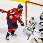 Pittsburgh Penguins goalie Matt Murray (30) makes a save as Washington Capitals center Marcus Johansson (90) looks on in the final minute of the third period in game two of the second round of the 2016 Stanley Cup Playoffs at Verizon Center.