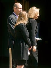 Hewlett-Packard CEO Meg Whitman, right, arrives for