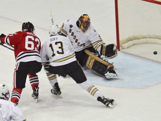 St. Cloud State's Patrick Russell (63) watches the